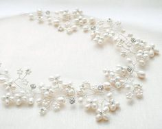 { freshwater pearl bridal halo }  { designed and intricately handcrafted in our studio }  Bridal headpiece, completely wired by hand using freshwater pearls, and Swarovski crystal & rhinestone elements.  All of our pieces are made-to-order, which means that after you place an order, your headpiece will be made in our studio especially for you! May be attached at each end with hairpins, or a ribbon.  Photography Photos 1-4: Brittany Lee, Ottawa, Canada  --------------------------  QUANTITY...