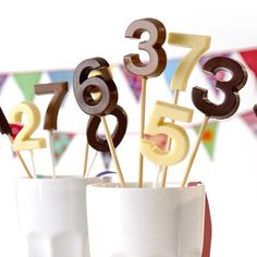 chocolate number lollipops. perfect for milestone birthday parties...now, how fun would a chocolate-themed birthday party be??