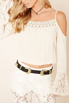 This faux leather belt by BTB™ features two high-polish buckles with etched floral motifs.