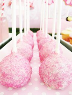 Pink glittered cake pops.