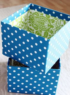 Fabric-Covered Boxes - Use indoor/outdoor fabric. Cut top four flaps off so left with open top box. Attach fabric (follow blog directions) Add grommets and cotton rope (with ends taped) and knot on backside.