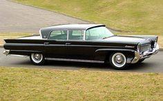 Black 1958 Lincoln Continental MK III 4-Door Hardtop Sedan, roll down back window, suicide doors & me driving it. Perfection.