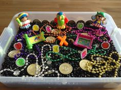 Pirate Sensory Bin - It contains black beans, gold coins, plastic diamonds, party necklaces, party rings, pirate little people and a letter x (x marks the spot) - Preschool Activity - Kids Activity