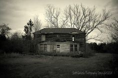 """""""Eye of the Storm"""" An old homestead, with it's lone open window, appears to keep a weary eye on an approaching storm. Dark clouds, as if snagged by the skeletal branches of an old oak, seem to tear as they move across the sky. (2014) For more photos please check out my page at Scott Garlock Photography https://www.facebook.com/scottgarlockabandoned and if you like what you see, I sure would appreciate a good old fashioned """"Page Like"""" Thank you! - Scott"""