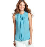 Tie Neck Shell - Detailed with ties at the neckline for a flirty touch, this sleek shell is a true marvel. Split neck with ties. Sleeveless. Tonal button front.