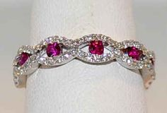RUBY AND DIAMOND RING IN 18KT WHITE GOLD kinda my dream wedding band