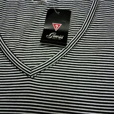 CLASSIC- NWTblack/white shirt Cute little blk/wht striped short sleeve shirt. New! Cute, cute. Guess Tops