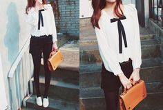 Love this classic combination of black and white along with a hint of brown with the satchel purse.