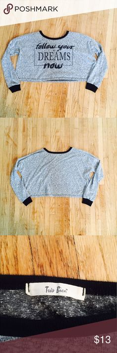 "Graphic, Long Sleeved, Boxy Cropped T-Shirt 👚 Graphic, Long Sleeved, Boxy Cropped T-Shirt: ""Follow your dreams now"" design on front, heather gray and black color, boxy fit. Slightly worn but still in new condition. 😊 Très Bien Tops Crop Tops"