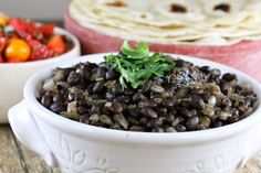 Mexican black beans are a perfect, easy side dish for any Mexican cuisine. Flavorful, and packed with good-for-you nutrients, these restaurant-style black beans are a treat worth making. Mexican Dishes, Mexican Food Recipes, Mexican Black Beans, Marinated Flank Steak, Black Bean Recipes, Cooking Recipes, Healthy Recipes, Carne Asada, Cooking On The Grill