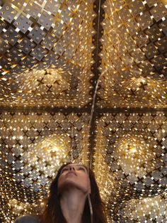 Cosmic Quilt is an interactive installation made frompaper, aluminum, stepper motors, and arduino. Censorsrespond to the environment and continuously alter its shape and in consequence create varying light patterns on the floor.