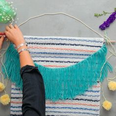 Projects Boho Running out of DIY projects? Knot to worry! Take an old rug to a new level by turning it into a wall hanging. This macrame and weaving project is the perfect addition to a boho-modern space! Diy Home Crafts, Diy Arts And Crafts, Yarn Crafts, Diy Yarn Decor, Homemade Crafts, Macrame Wall Hanging Diy, Macrame Art, Macrame Wall Hangings, Weaving Wall Hanging