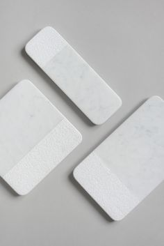 A set of marble serving trays, where they explore traditional craftsman techniques to create unique finishes on the stone. These finishes result in a special patina that develops after a few uses.