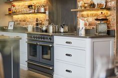 The Main Company designed this bespoke kitchen to blend seamlessly with the rest of this Yorkshire property using reclaimed oak wood and painted cabinets. Kitchen Diner Extension, Open Plan Kitchen Diner, Open Plan Kitchen Living Room, Barn Kitchen, Kitchen Dining Living, Shaker Kitchen, Family Kitchen, Rustic Kitchen, Kitchen Ideas