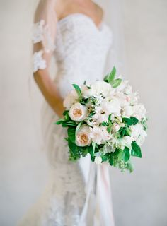 Classic blush and white bouquet: http://www.stylemepretty.com/2016/07/14/forget-catching-pokemon-catch-these-wedding-bouquets-instead/