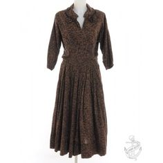 Must have black & brown 1950's long sleeved dress with a revere front and dolman sleeves.  www.beyondretro.com
