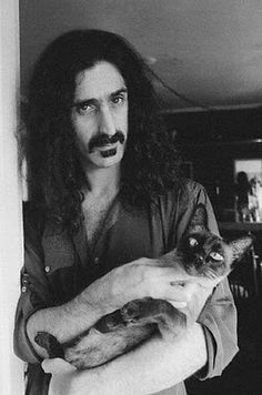 American composer, singer-songwriter Frank Zappa and his cat (late 1970's)