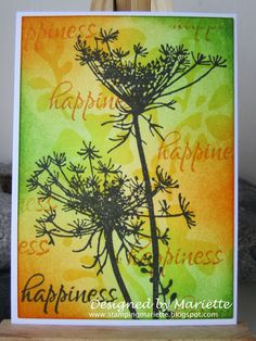 By Mariëtte. Background may have been sponged through a stencil. Then foreground flowers & sentiment stamped in black.