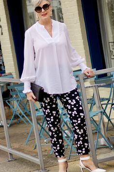 slice of life - Walmart Fashions - Ideas of Walmart Fashions - beth from Style at a Certain Age wears an outfit from Lord & Taylor black pattern pants white tunic blouse Sam Edelman shoes. Over 60 Fashion, Over 50 Womens Fashion, 50 Fashion, Look Fashion, Fashion Outfits, Casual Chic, Blouse Designs, Plus Size Outfits, Ideias Fashion