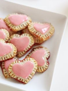 Celebrate Valentine's Day with homemade mini strawberry pop tarts. In a heart shape, of course!