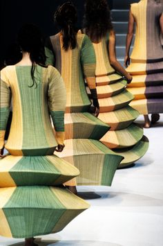 """Issey Miyake had a collection called """"Pleats Please"""" which was voted the most popular collection of 1993. The pleats are similar to the pleated dresses from the 40s. Miyake is known for outrageous clothing that is not actually worn in public."""