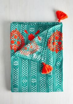 Cozy up with this turquoise and orange blanket.