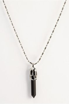 Featuring a long black glass crystal pendant, this edgy men's necklace exudes…