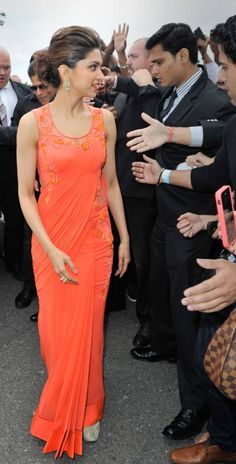 Deepika Padukon looks gorgeous in orange #uniqesaree For More Designer sarees Visit:http://www.ethnicwholesaler.com/sarees-saris