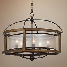 This open cage chandelier design features natural wood and metal elements with 5 lights behind a sheer fabric shade. Style # at Lamps Plus. Craftsman Lighting, Farmhouse Lighting, Rustic Kitchen Lighting, Cottage Lighting, Entry Lighting, Dining Room Lighting, Table Lighting, Lighting Ideas, Dining Room Light Fixtures