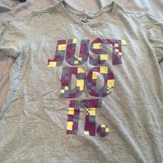 "Nike Slim Fit Tee women's size Large Nike Slim Fit Tee. Womens size Large. Grey with ""Just Do It"" on shirt Nike Tops"