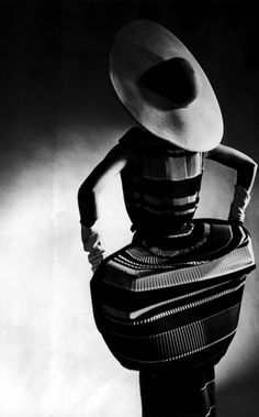 Gjon Mili-Model showing off mushroom pleats in the slim sheaths that hang in plumb-line straight panels when the wearer stands still & billows out when she moves, featured in this Traina-Norell creation compete w. straw cartwheel hat by Mr. Foto Fashion, Fashion History, Fashion Art, Vintage Fashion, Fashion Design, 1950s Fashion, Fashion Portraits, Fashion Pics, Vintage Vogue