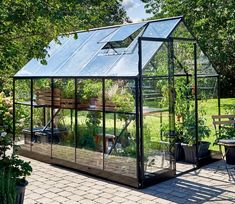 Design Purity - Modern, sleek, plus functional, the Halls Qube. A greenhouse for those who appreciate simple things, done well. See more at Greenhouse Stores.