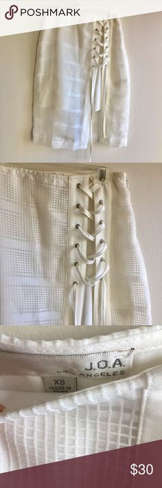 """[revolve joa] white mesh skirt w criss cross tie This is a very intricately detailed piece of white mini skirt w longer mesh overlay. It also roasts a cross cross tie on the side. Looks great w crop tops, body suits, and tank tops. 22.5"""" long, 12.5"""" wide laying flat. Great condition. REVOLVE Skirts Pencil"""