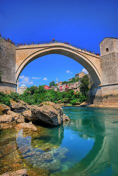 Old Bridge area of Old City Mostar, Federation of Bosnia and Herzegovina Places Around The World, The Places Youll Go, Around The Worlds, Oh The Places You'll Go, Montenegro, Wonderful Places, Beautiful Places, Les Balkans, Mostar Bosnia