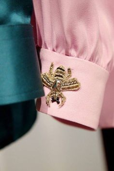 Gomden bee brooch on wrist cuff