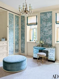 The wife's dressing room, lined in a hand-painted Gracie wallpaper, is furnished with an American mirrored desk and an Italian brass stool, both vintage pieces from John Salibello, as well as an S. R. Gambrel–devised ottoman covered in a Clarence House silk | archdigest.com