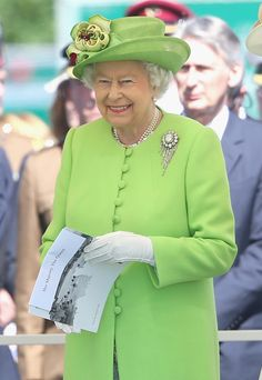 Queen Elizabeth II at Bayeux Cemetary during D-Day 70 Commemorations on June 6, 2014 in Bayeux, France. Friday 6th June is the 70th anniversary of the D-Day landings which saw 156,000 troops from the allied countries including the United Kingdom and the United States join forces to launch an audacious attack on the beaches of Normandy, these assaults are credited with the eventual defeat of Nazi GermanY
