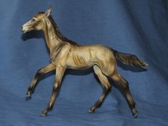 Resin:  Morgana  Traditional Akhal-Teke Filly sculpted by Laila L. Mampell  http://www.patch-of-heaven.de/frameset.html  Color:  Buckskin  Painter:  Laura (Dotson) Thomson  http://www.aeriehills.com
