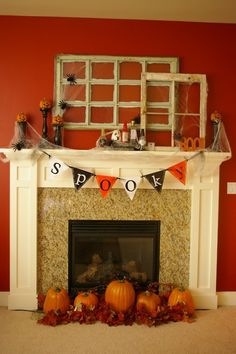 love the pumpkins in front of the fireplace