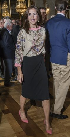 Crown Princess Mary looking great in a floral blouse from Sand and a black skirt.
