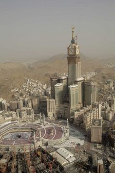 Abraj Al Bait towers under construction in Mecca, Saudi Arabia. The tower features world's largest clock face (43 meters or 141 feet diameter) and it's also world's highest clock tower (607 meters or 1991 feet).