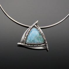 'Sea and Sky' Larimar and Sterling Silver Pendant Larimar is good for calming excess energies and it balances energies. This stone allows for open communication between souls, lovers and friends.