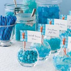 Here would be one way to have the party favor. Like they gave them the glasses with the name tag and they could grab the candy they wanted!
