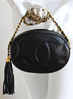 1980's CHANEL oval black leather 'CC' bag with gilt chain image 2