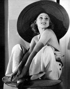 Vintage 1930's beach fashion - Ann Sothern in a wide brim sun hat, beach pajamas, and halerneck top