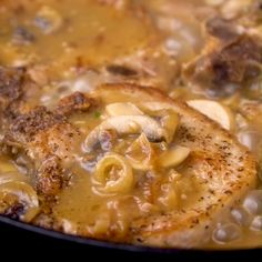 French Onion Smothered Pork Chops Seasoned Pork Chops are smothered in a thick and flavorful French Onion sauce with gravy and mushrooms. They are pan fried or baked in the oven. Top with hot, melted cheese for extra indulgence! Oven Pork Chops, Pork Chops And Gravy, Pork Chops Mushroom Gravy, Pork Chops With Mushrooms, Sauce For Pork Chops, Easy Pork Chop Recipes, Pork Recipes, Cooking Recipes, Bean Recipes