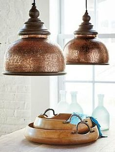 Shed a vintage light on your home's décor with the Micah Pendant; finished in brilliant copper and adorned with a rich wooden trim.