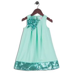 Razzle, dazzle! Wide pleats enhance the neckline while providing fullness and comfort to the skirt. A dazzling bow on the shoulder and a wide band at the hemline provide this classic shift dress a little bit of shimmer, sparkle and glam for any youngster. Fully lined with a loop and button closure in the back, your child will 'teal' the love wearing this little number. #JoeElla #SPRINGspiration #LETACABBAGE