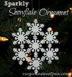 Sparkly Snowflake Ornament by virginiasweetpea.com You could do this with ready made snowflakes. It would be a big ornament, maybe great to hang in the window.