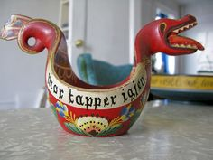 Norwegian dragon cup. (Mor tapper igjen~mother pours again.)kn